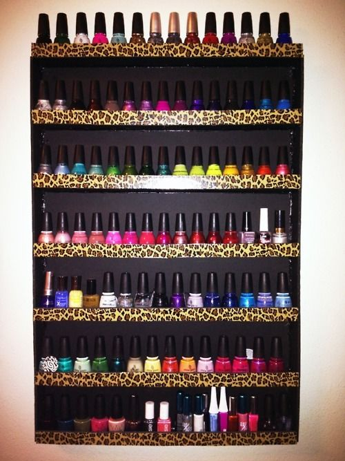 make your own nail rack using foam boards, hot glue and duct tape. I am SOO doing this next payday - the dollar store has fancy duct tape now - I'm thinkin' zebra print for mine...