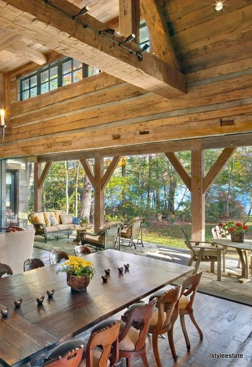 I love how this opens up to the deck and outside like this - lots of air and light and gorgeous landscape outside.  Found on http://blog.styleestate.com/style-estate-blog/family-lake-lodge