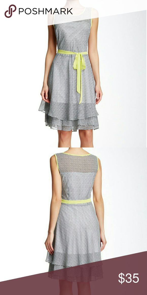 Robbie Bee Polka Dotted Sleeveless Dress Fun and stylish with black polka dots,  lime green trim, removable waist tie, scoop neck,  and super cute layered tail, featuring a high- low hem. The dress is lined and made of 100% polyester, machine washable in cold water. Robbie Bee Dresses