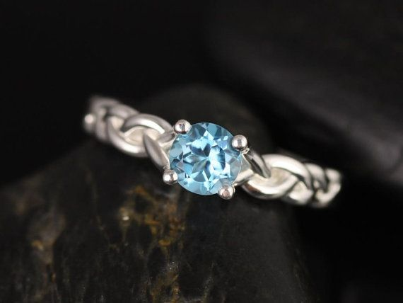 This would be pretty in white gold. Prudence Silver Round Sky Blue Topaz Braided by RosadosBox on Etsy, $85.00