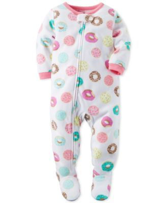Bedtime is a whole lot sweeter with these fabulous donut-print footed pajamas-featuring an ankle-to-chin zipper for easy changes-from Carter's. | Polyester | Machine washable | Imported | Solid ribbed