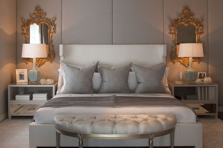 Perfect symmetry of light hues of grey and touches of gold - mirror ornaments and geometric cushion fabric textures add personality to this bedroom design.  Hyde Park Apartments – Intarya luxury interior design