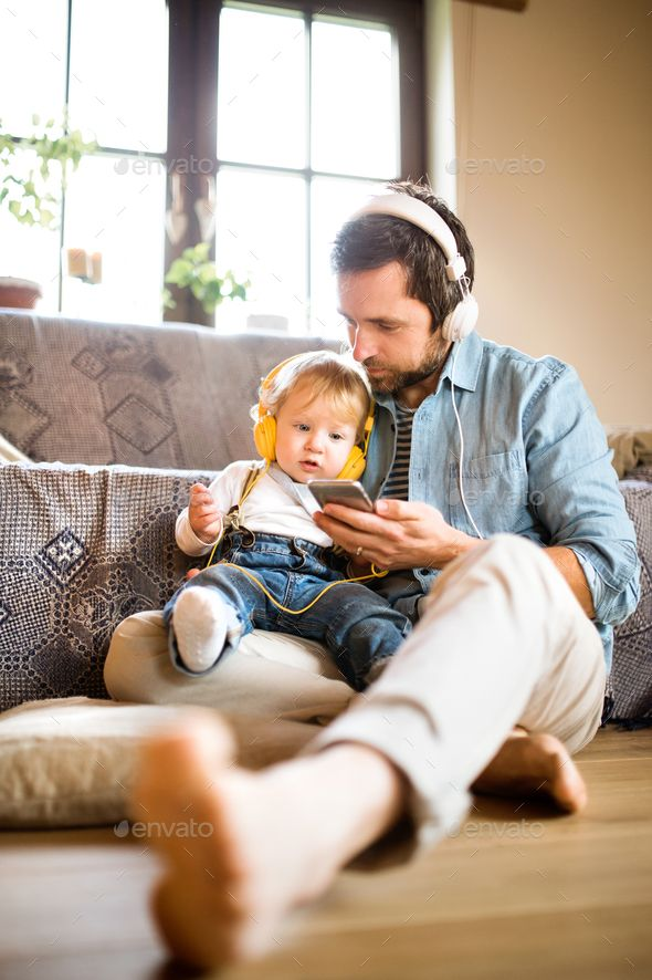 Father And Son With Smartphone And Earphones Listening Music Father And Son Young Fathers Technology Photos