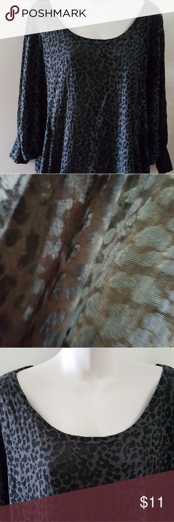Dark Gray animal print dolman sleeve top Dark gray animal print semi-sheer top with dolman cuffed 3/4 length sleeves.  Very cute and hangs perfectly over a pair of jeans or skirt. Freeloader Tops Tees - Short Sleeve