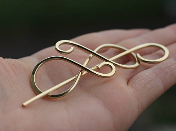 A fine and gorgeous god hair clip or shawl pin made with thick ...