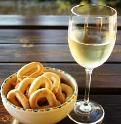 homemade taralli & wine. I had the black olive version from the Italian grocery store by Rallini...it was the perfect snack. Even Roxy loved it