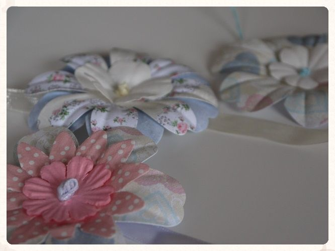 A pack of ten pretty ribbons with layered big bloomer flower cut-outs attached These could be used for a variety of crafts to complement any style