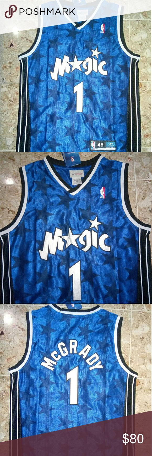 NBA Orlando Magic Tracy McGrady Throwback Jersey I am selling a brand new Men's NBA Orlando Magic Tracy McGrady throwback jersey. This jersey is a fantastic jersey that looks even more fantastic in person. It is in a size Men's Medium. Please serious interests only. Reebok Shirts Tank Tops