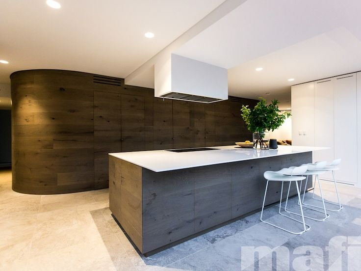 Design firm, C+M Studio explored contrast between different spaces through the use of the mafi curved Oak Country Brushed Grey Oil feature wall, in which doors leading to private spaces were hidden, flush with the finished face of the wall. Photo by Caroline McCredie.
