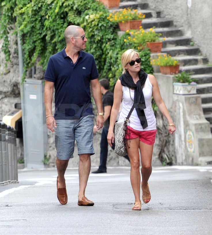Reese Witherspoon and Jim Toth walk in Italy.