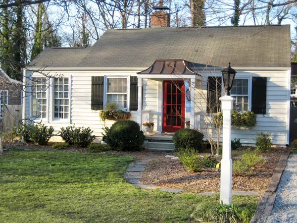 This sweet Greensboro, NC cottage got a full frontal makeover on a tight budget thanks to smart use of salvaged and locally sourced materials. See the transformation here. | thisoldhouse.com