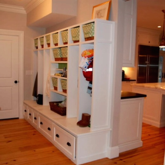Open mudroom with basket storage. Love that all the baskets have matching liners.