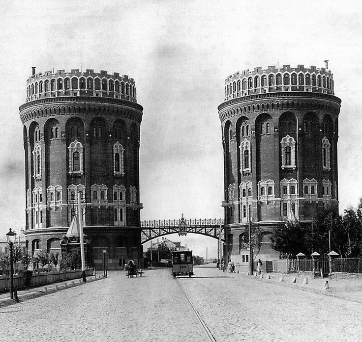 1890s.Horse-driven tram on the Cross Outpost Square Крестовый форпост,(now Riga Square Площадь Риги,water towers on the background (built in 1890-1893 by Max Hoeppener.