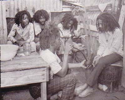 """Hugh Mundell far left. Hugh Mundell is a teenage prodigy who makes one of the greatest reggae roots records of the """"golden age of reggae"""" at the age of 16. """"Africa Must Be Free"""" is produced by Augustus Pablo. Mundell writes all the tunes, thereby earning himself the nickname of """"The Blessed Youth."""""""