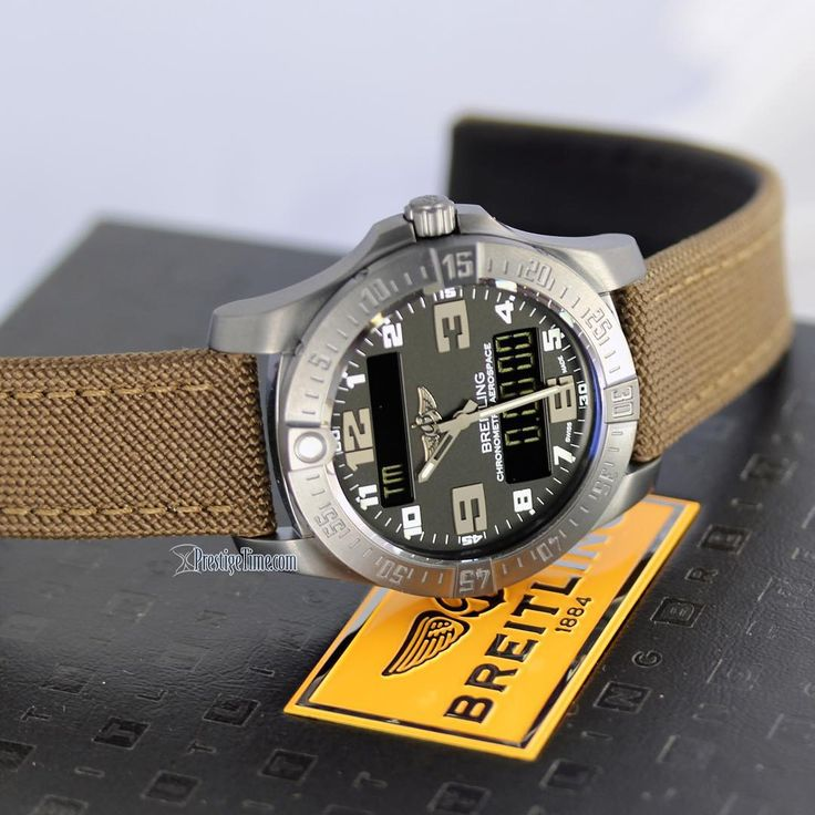 Breitling Aerospace Evo Night Mission – a multifunction electronic watch with a non-glare stealth-look brushed black titanium case, matte black dial, Brown military fabric strap & blacksteel tang buckle. This digital analog watch is powered by Breitlings COSC Certified SuperQuartz Thermo-compensated Calibre 79 the watch features a 1/100th of a second chrono, countdown timer, alarm, perpetual calendar, 2nd time-zone & an audible indication of the time. Also the backlighting is NVG…