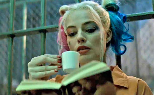 The Show Stealer: Apart from the surprising, lighter, Guardians of the Galaxy-ier tone of the second trailer, the big takeaway from the preview is how clearly this movie is already being stolen by Margot Robbie as Harley Quinn. The first shot of Harley -- reading a romance novel in her cell over tea (pinky up, of course) -- is such a great character moment that it's obvious how much fun director David Ayer is having with the character. #SuicideSquad