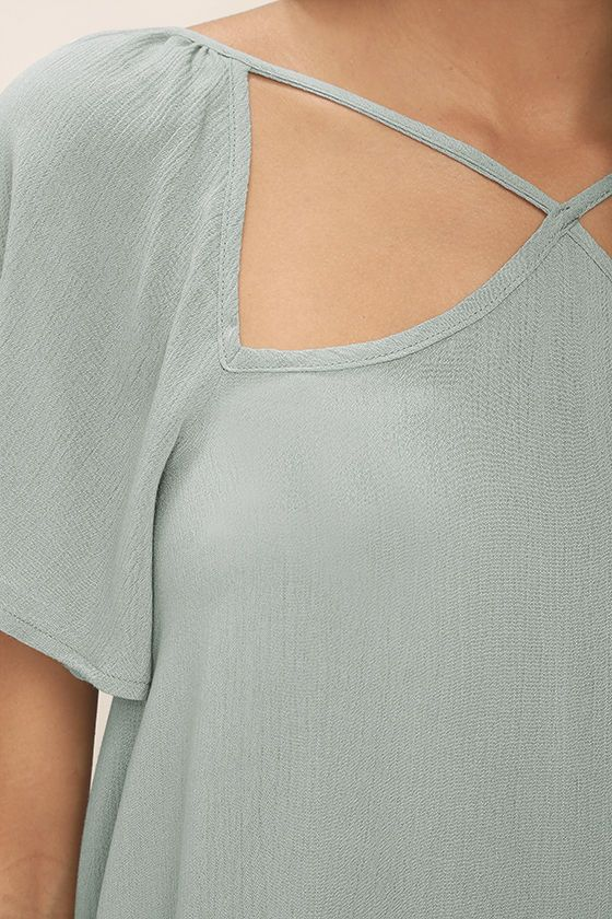 We want to keep the Safekeeping Slate Blue Top close to our hearts! Breezy rayon in a cool blue meets grey shade shapes a strappy neck and back, fluttering short sleeves, and relaxed, wide-cut bodice.