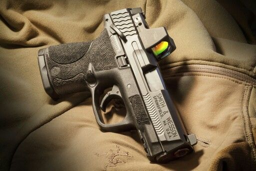 Smith & Wesson M&P Shield... would love to shoot with this sight... might be cool.