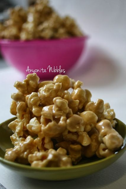 Gooey, sticky marshmallow caramel popcorn makes an ideal dish for parties from www.anyonita-nibbles.com