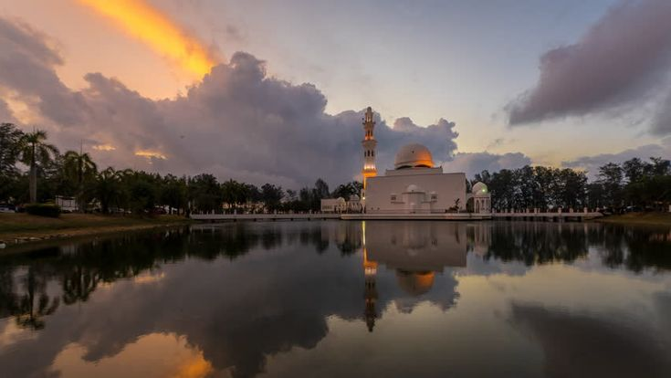 Floating Mosque With Fast Moving Clouds during sunrise, Timelapse. Mosque Tengku Tengah Zaharah or also known as Floating Mosque in Kuala Terengganu, Malaysia with perfect reflection.