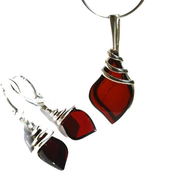 Pretty twisted sterling silver settings with cherry amber. #fancyjewellery…