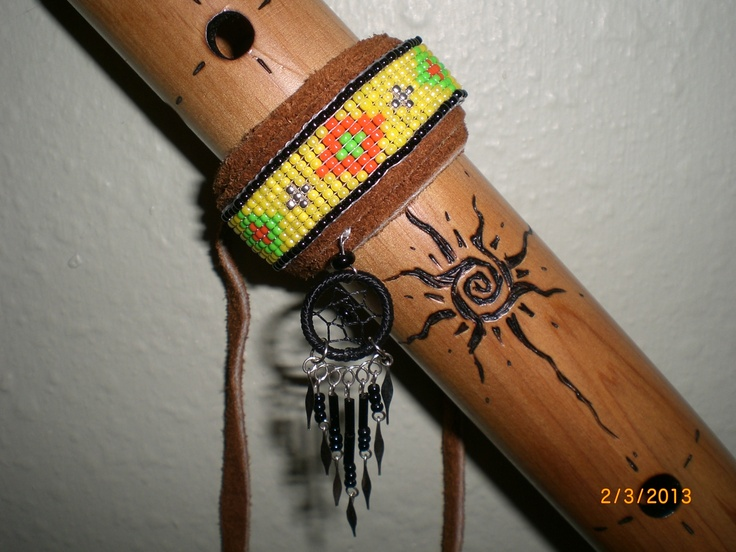 My Ed Dougherty/Tree of life designs Native American Style Flute, with a beaded wrap I made and sold on ebay.