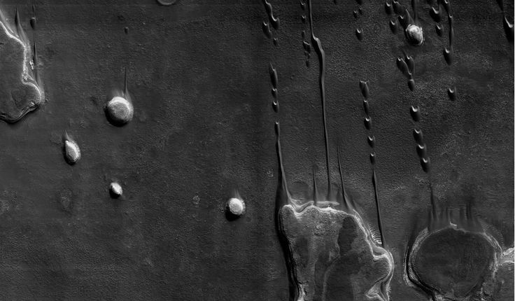 """Image from the book """"This is Mars,"""" photographs by NASA/MRO, by Xavier Barral, with texts by Alfred S. McEwen, Francis Rocard, and Nicolas Mangold (Aperture)"""
