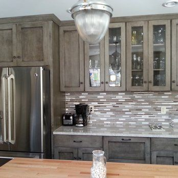 Appaloosa cabinets made by Schuler- grey cabinets with white counter top and backsplash