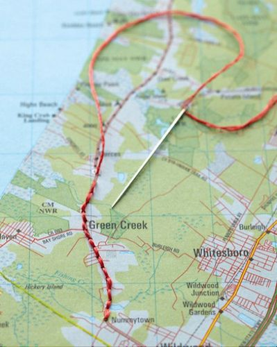 Embroider a trip on a map and then frame it.  doing this for the AT!