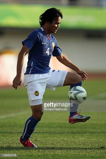 Mohd Omar of Malaysia controls the ball during the Men's Football Group A pool match between Malaysia and Japan ahead of the 16th Asian Games...