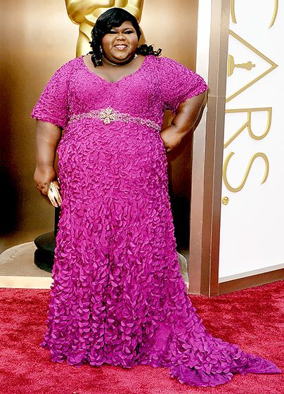 Gabourey Sidibe in a fuschia Theia gown with hand-embroidered laser-cut petals for the 2014 Oscars