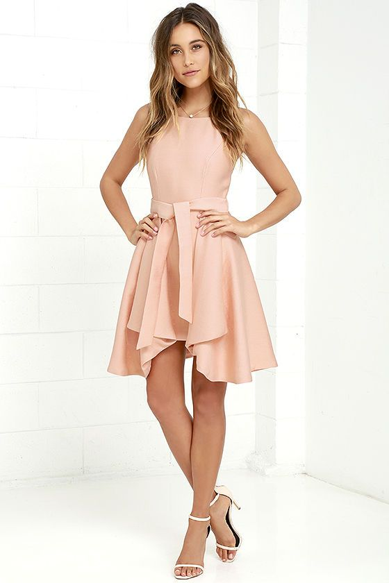 Fun and fancy are just a few of the many qualities the C/MEO Two Can Win Peach Dress possesses! Rounded spaghetti straps top a squared-off neckline and princess-seamed bodice. A woven skater skirt flares from the waist except at front, where the sexy sheath skirt makes a peekaboo appearance. Tying waist sash. Hidden back zipper.