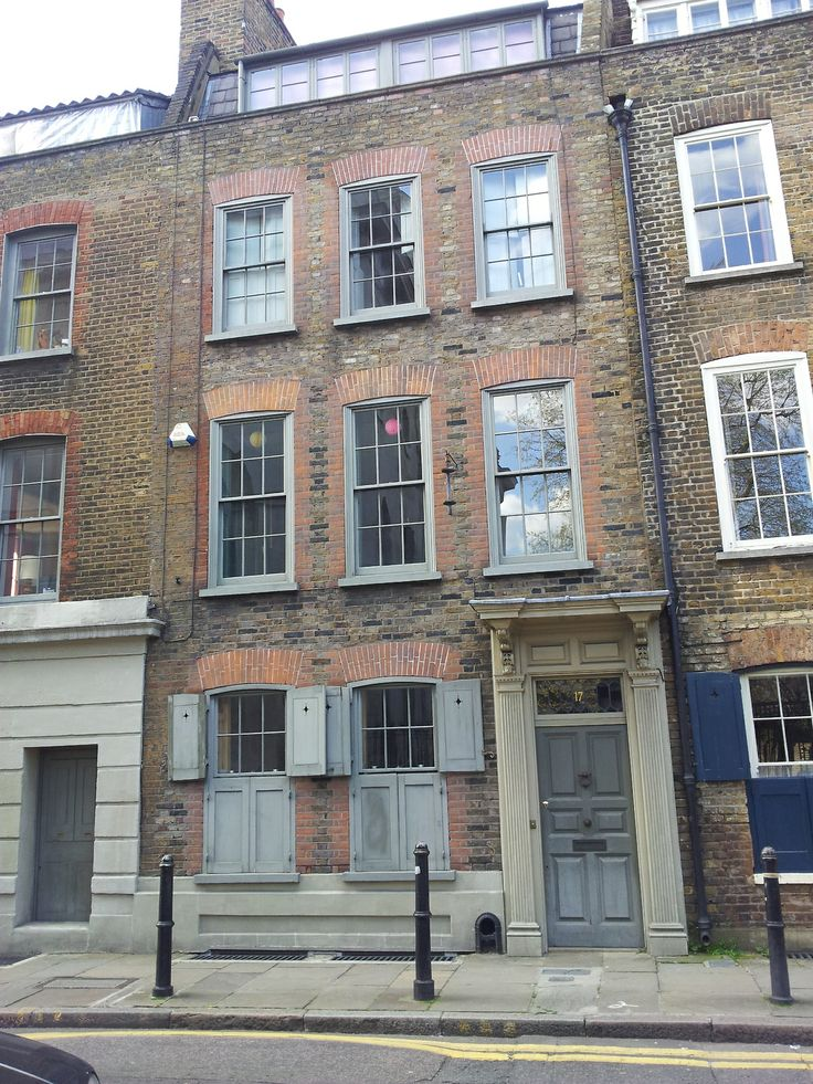 Huguenot silk weavers' houses in Fournier Street. At the top is the 'mansard roof' where the weavers worked to get maximum light. They would have latticed windows.