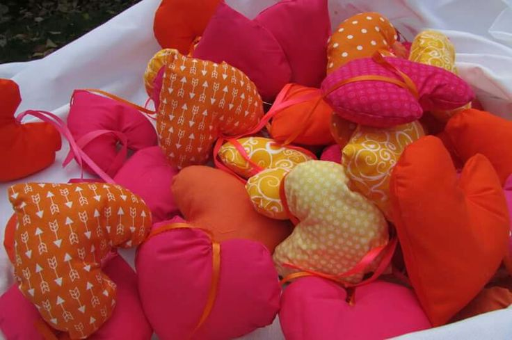 Hot pink and orange fabric hearts. My sister sewed over 100 of these that we tied to each chair and hung from the tent.