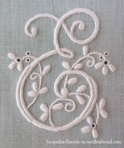 embroidered e monogram using traditional monogramming techniques