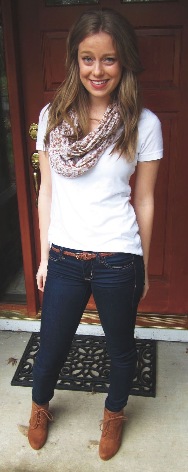Comfy outfit white tee slightly tucked in, floral scarf, skinny jeans,  wedge