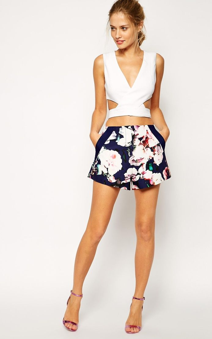 Floral shorts - these floral shorts wil make you look cute. Wear it with short/long sleeve wrap top and heeled sandals.