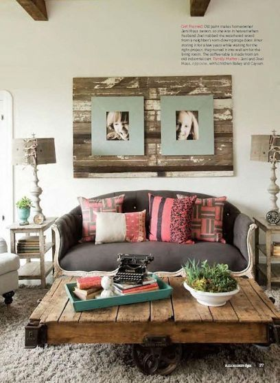 I call this room: Warm & repurposed. A one-of-a-kind couch stands out in the room, while the reclaimed wood adds a charming, rustic feel. Don't forget family portraits are a must! (Especially of kiddos)
