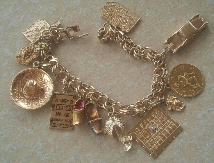 vintage 14k gold charms Bracelet hefty 44.5 grams amazing beautiful charms.