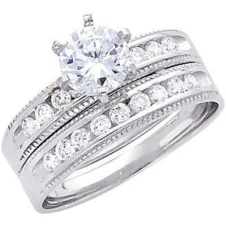 Engagement Ring and wedding band set. White gold decorated with CZ. 14K | 4.9 gr. ----------------------------------------  Anillo de Compromiso y Banda matrimonial PARA dama. Oro blanco decorado con CZ. 14K | 4.9 gr.