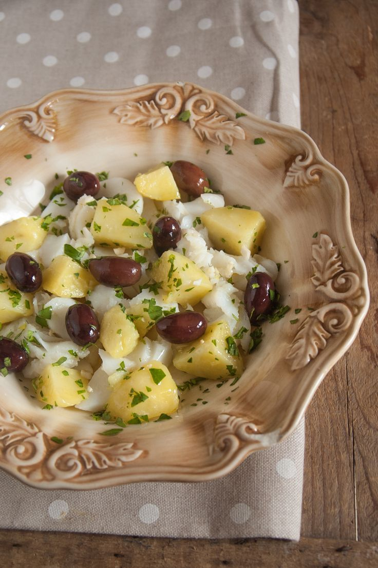 A perfect dish for a hot summer day: salad of cod, potatoes, black olives and parsley