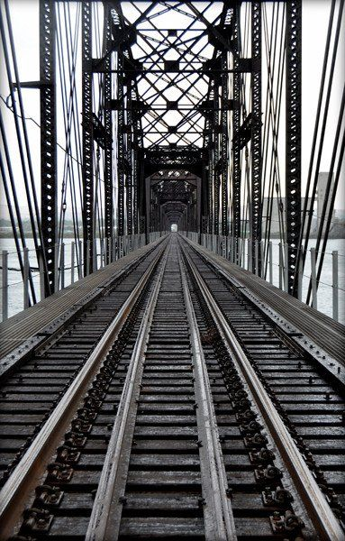 Contemporary abstract digital black and white composition of an old train bridge. Using a digital photography image, the high quality giclee print is created using archival pigment inks on acid free h