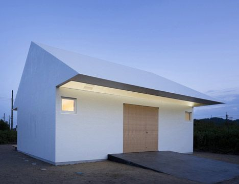 "Tokyo studio International Royal Architecture designed this seaside house with the ""form of a pure white arrow"""