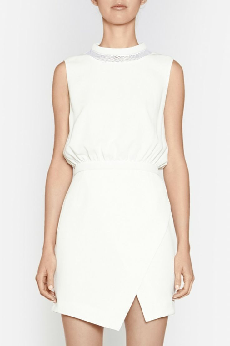 Camilla and Marc | SUPPLIMENTARY DRESS  US$447.71 Party dress designed in a white waffle fabric with a mesh panel at the neckline. Features a wadded neckline and waistband, blouson-style bodice and wrap-style skirt. Includes a hook and eye fastening at the neck and invisible zipper at the centre back.