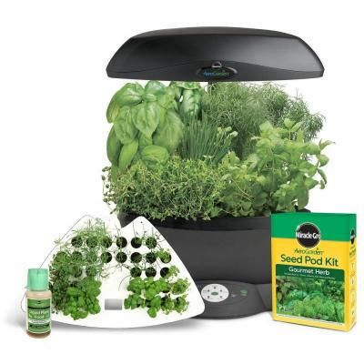 With the Miracle-Gro AeroGarden 6, your herb garden can be *in the kitchen.* It delivers big yields with a smaller, space-saving, corner friendly design. Ideal for year-round, countertop kitchen gardening, it starts more than 30 seedlings with optimal conditions for transplant to your outdoor garden or container garden.