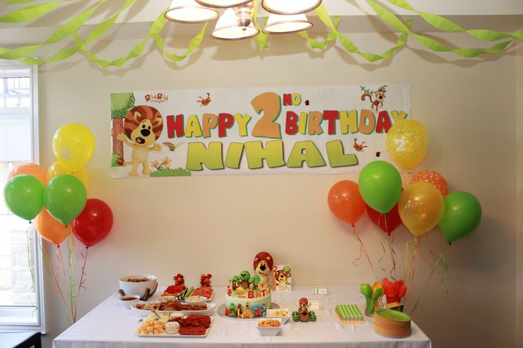 Cake and snack table. Personalized banner with theme coloured balloons.