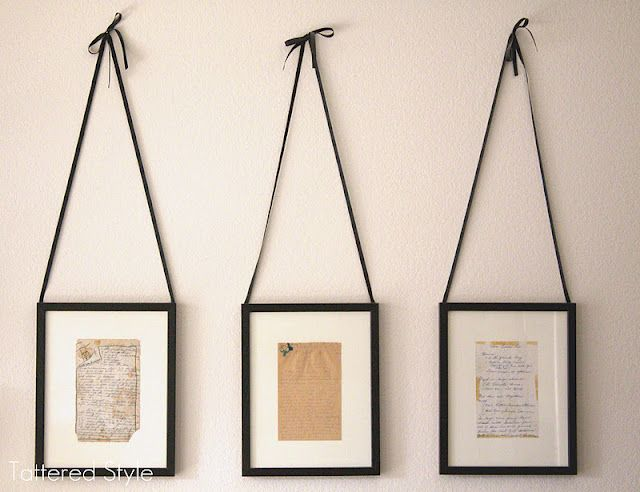 grandma's old recipes, preserved and protected in simple black frames and hung with black ribbon. simply lovely.