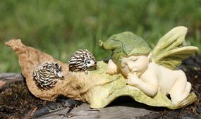 Sleeping Fairy Baby with Hedgehog  Price $13.40