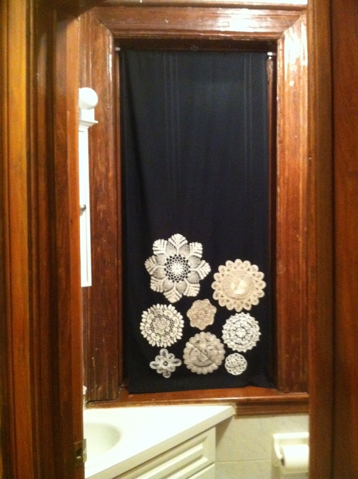 Bathroom curtain...bought black fabric, sewed to make a curtain and used fabric glue to adhere vintage thrift shop doilies.