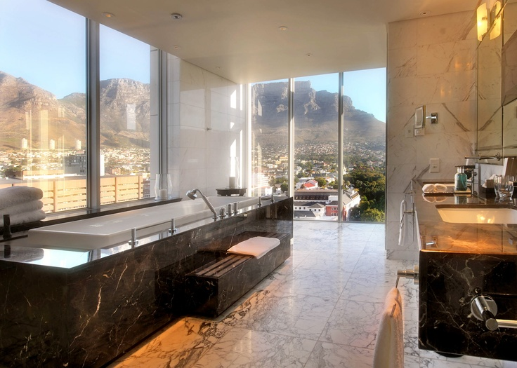 Taj Cape Town's Presidential Suite Bathroom with long, marble soaking tub and floor to ceiling windows #WorldsBestHotels2014